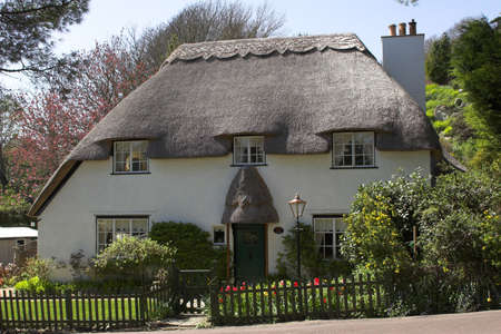 homely: Thatched white country cottage