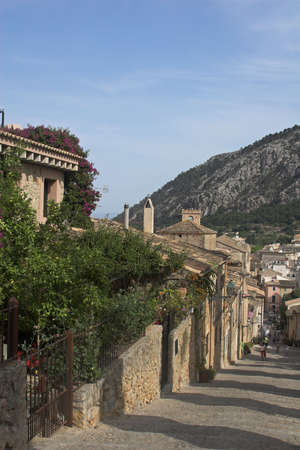spanish village: spanish village on hillside with cobbled steps and people Stock Photo