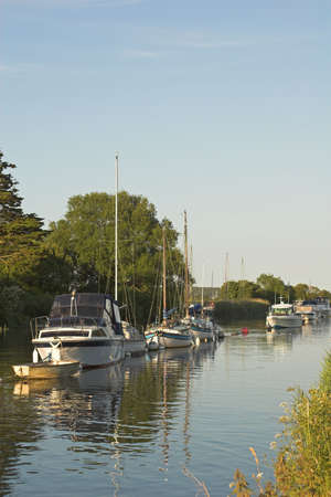 tranquil river scene with boats photo