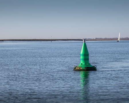 green starboard channel marker buoy in UK waters