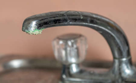 corrosion and limescale on a chrome tap Stock Photo