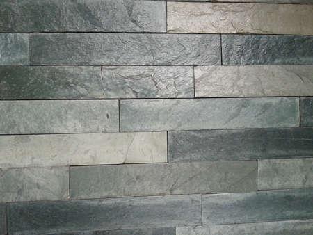 grigiastro: pietra grigia strutturato sulla parete