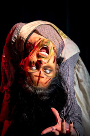 Horror Character; Possessed female with special effects makeup