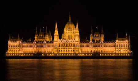 The Parliment Building in Budapest is already a great and impressive place during the day. But when you go back at night and see it with all those lights, its even way better! And the Danube in front gives a great reflection of all those lights which mak Editorial