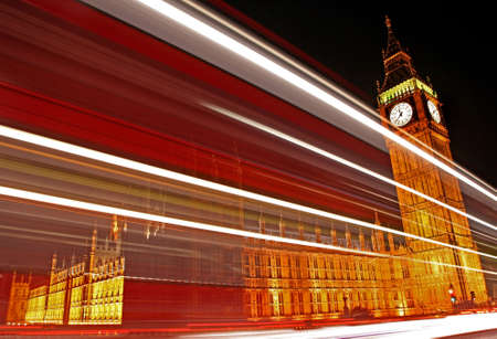 The light trails of a London bus passing the Houses of Parliament.