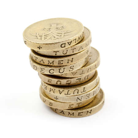 money pounds: Stack of £1 coins.