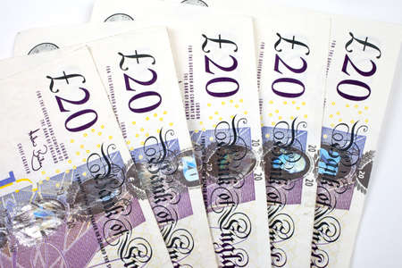 Five £20 (twenty pounds) notes adding up to �100. photo
