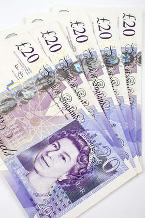 bank note: Five £20 (twenty pounds) notes adding up to £100.