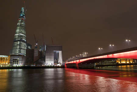 The Shard and London Bridge at night. photo
