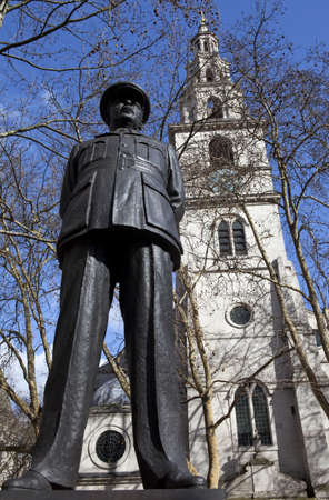 clement: A statue of former RAF leader Bomber Harris with St Clement Danes Church (Central Church of the Royal Air Force) behind. Stock Photo