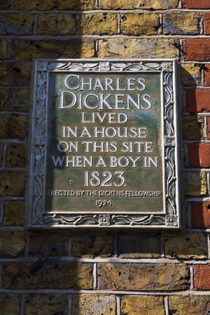 dickens: Plaque on Bayham Street in Camden, London locating the site on which Charles Dickens once lived. Editorial