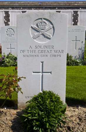ypres: A gravestone of a soldier of the Great War in Tyne Cot Cemetery in Ypres  Stock Photo