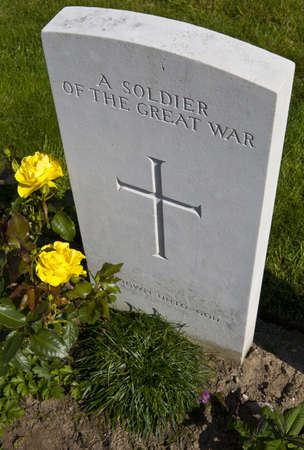 world war one: A gravestone of a soldier of the Great War in Tyne Cot Cemetery, Ypres