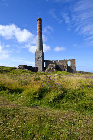 Remains of the old Engine house chimneys at Levant Tin Mine in Cornwall photo