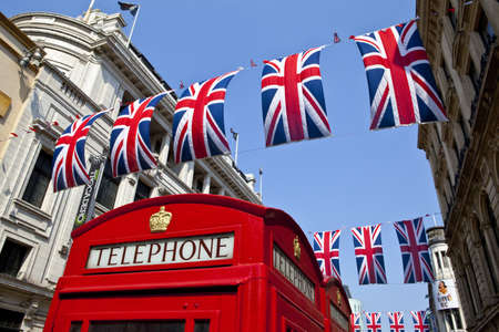 phonebox: A Red Telephone Box and Union Flags in London.