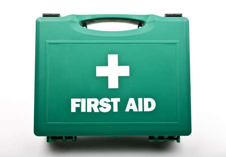 attend: A First Aid Box on a white background. Stock Photo
