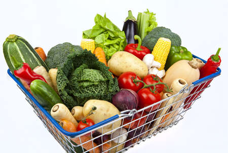 A shopping basket full of Vegetables on a white background. photo
