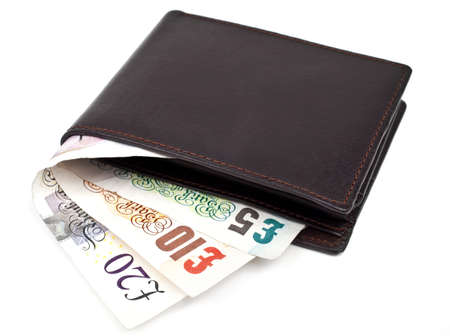 Three cash notes poking out of a wallet on a white background. Stock Photo