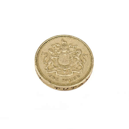 A one pound coin on a white background. photo