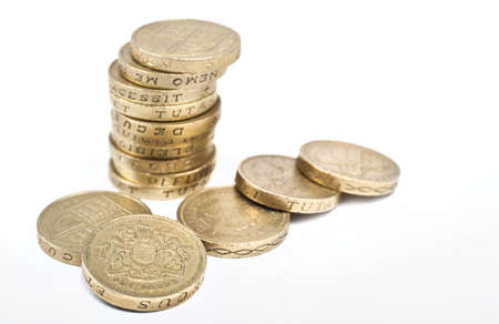 One Pound coins on a white background.