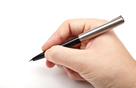 script writing: Hand holding a pen in the writing position. Stock Photo