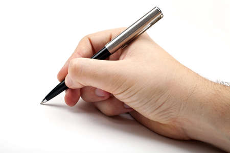 Hand holding a pen in the writing position. Stock Photo