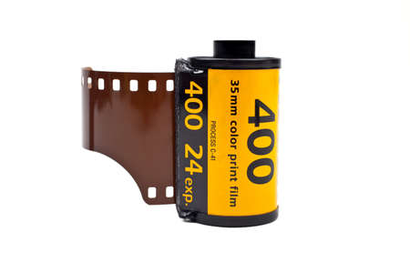 photographic film: A roll of Photographic film on a white background. Stock Photo