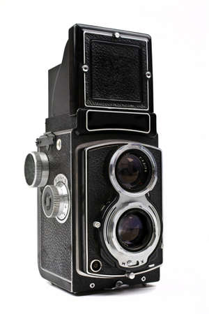 shutter aperture: A vintage Camera on a white background.