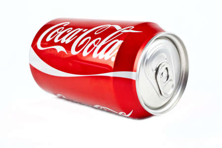 famous industries: Can of Cola over a white background. Editorial
