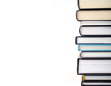 hardback: Abstract shot of a pile of Books over a white background.