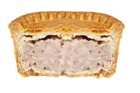 A Pork Pie half over a white background. photo