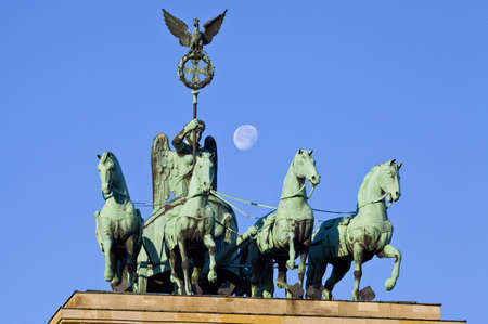 moon gate: The quadriga on the Brandeburg Gate in Berlin, Germany.