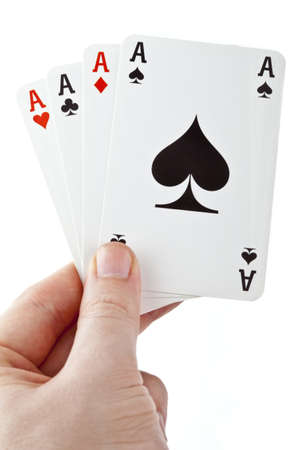 Hand holding four aces over a white background. photo