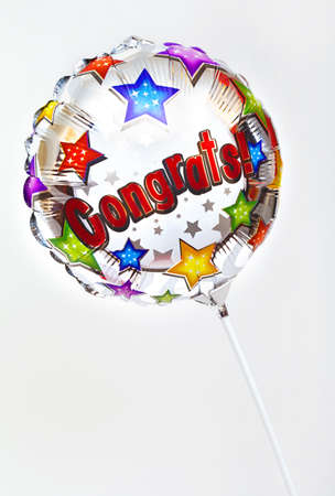 A Congratulations balloon over a plain background.