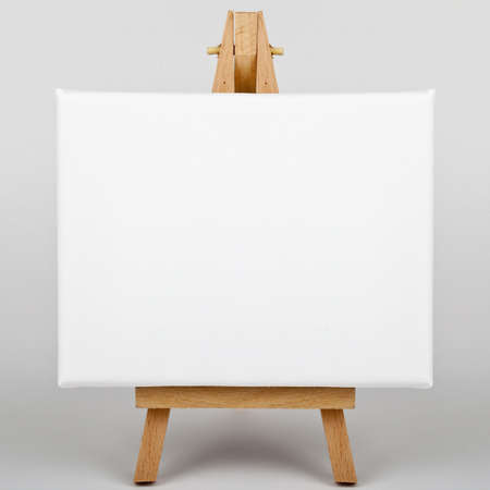 blank canvas: A white canvas on an easel. Stock Photo