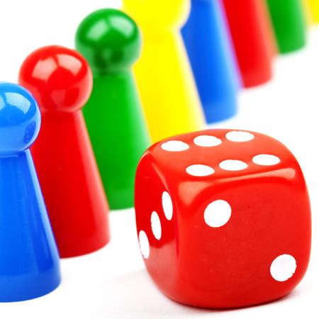 Board game Pieces and Dice over a plain white background  Stockfoto