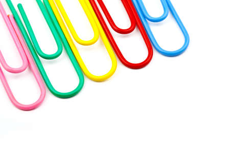 Abstract shot of Paper Clips over a white background. photo