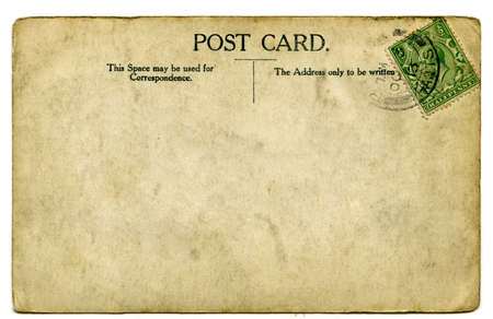 A vintage stamped postcard over a white background. Editorial