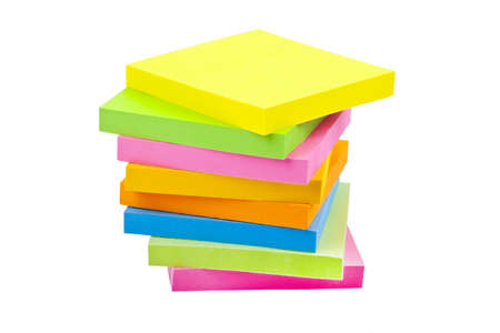 Stack of Sticky Note Pads over a white background. photo