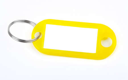 key fob: Yellow Key Tag isolated over a white background.