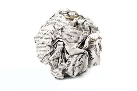 screwed: A screwed up piece of newspaper over a white background.