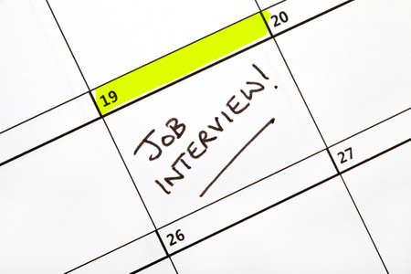 written date: Date for a Job Interview written on a Calendar. Stock Photo