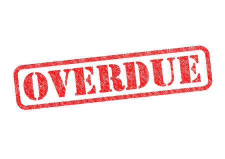 overdue: OVERDUE red rubber stamp over a white background. Stock Photo