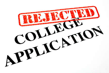 unaccepted: Close-up of a Rejected College Application letter.