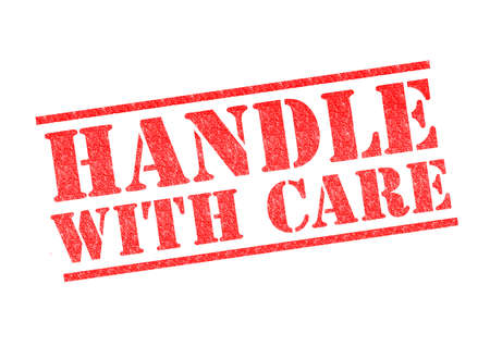 HANDLE WITH CARE rubber stamp over a white background.