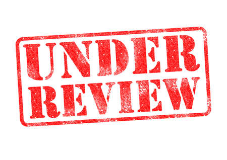 UNDER REVIEW red rubber stamp over a white background. Stock Photo - 17861861