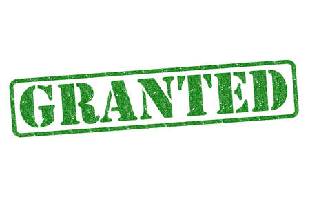 GRANTED green rubber stamp over a white background. Stock Photo - 17861876