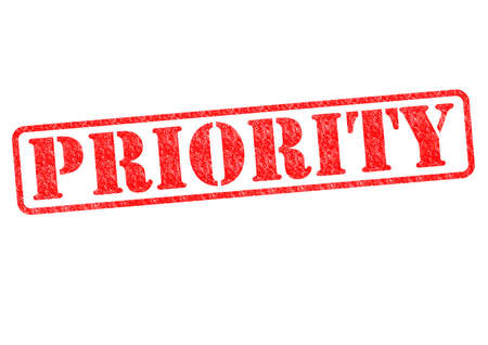 PRIORITY red rubber stamp over a white background. Stock Photo - 17861877