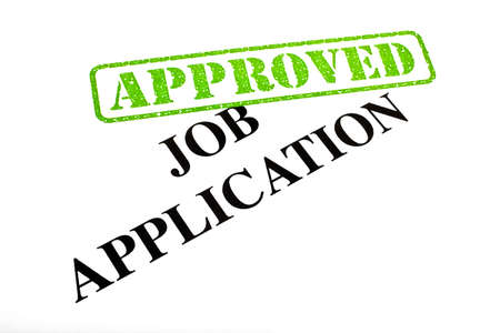 new job: A close-up of an APPROVED Job Application document. Stock Photo