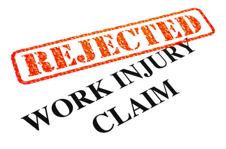 A close-up of a REJECTED Work Injury Claim document. Stock Photo - 18022018